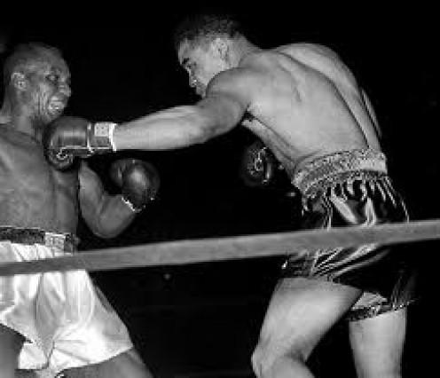 Joe Louis sticks Jersey Joe Walcott in defense of the heavyweight crown. Louis defended the heavyweight championship a record twenty five times.