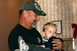 """""""Papa"""" Johnny consoling our grandson, Phoenix."""