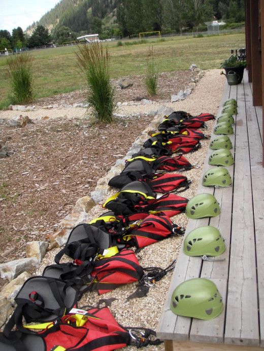 Helmets and harnesses ready for the next group of 10 at Tree Top Flyers, Chase, BC.