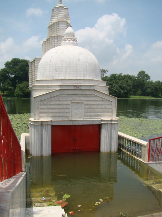 Half-submerged temple of the Goddess in the pond called Kshir Dighi