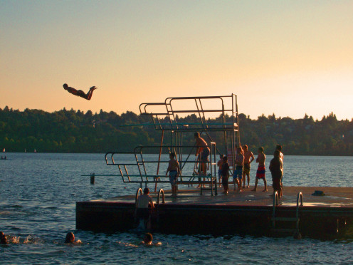 Man diving off high dive at Green Lake