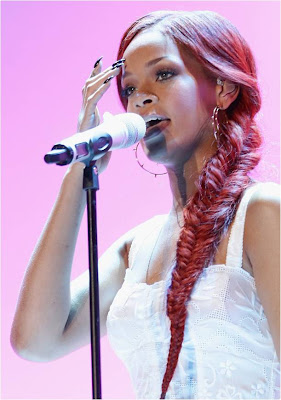 Rihanna in red fishtail braids