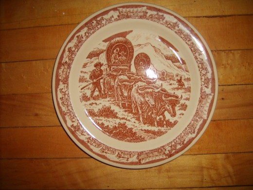 A vintage Wallace plate in the pattern of Pioneer Trails