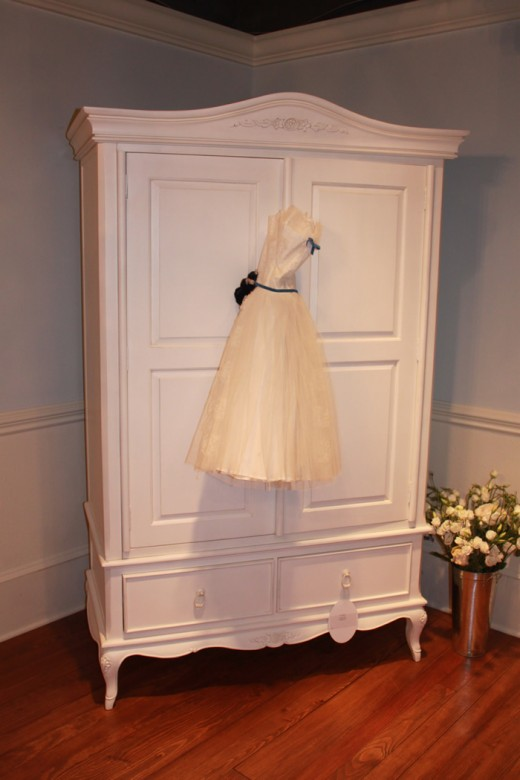 Signature Shabby Chic - Armoires to hold clothes  and decorate the outside with a vintage item.