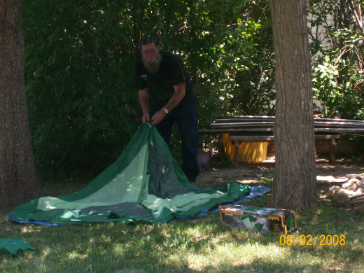 Bert setting up his tent in the yard.