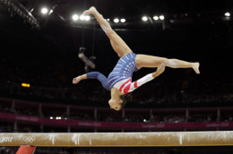 Alexandra Raisman inverted while performing on the balance beam in the 2012 Summer Olympics in London.