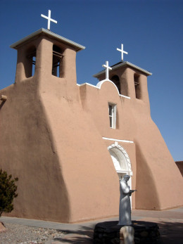 The front of the Ranchos de Taos Church is covered with adobe
