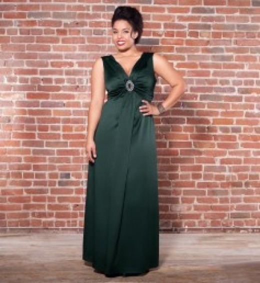 This bejeweled satin gown is a sure stunner. The draped neckline, framed by a sturdy v-neck, ruches into a glamorous rhinestone buckle at the center of the bust.  Price:  Sale $150.00
