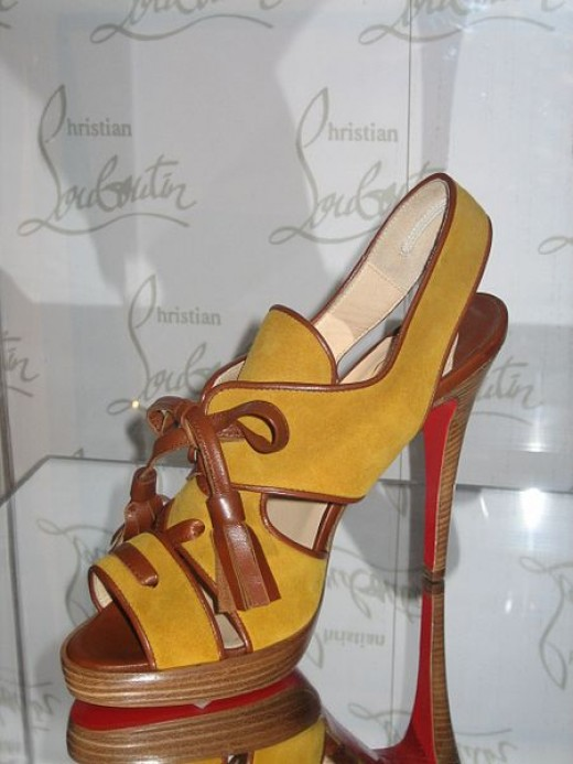 This shoe designed by Christain Louboutin was photographed at the Bata Shoe Museum by Sheila Thompson on February 28, 2006. Once again, notice Louboutin's trademarked red soles.