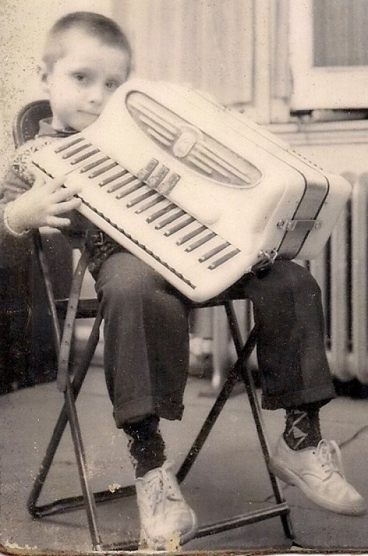 Learning to play the accordion at 6 years old.
