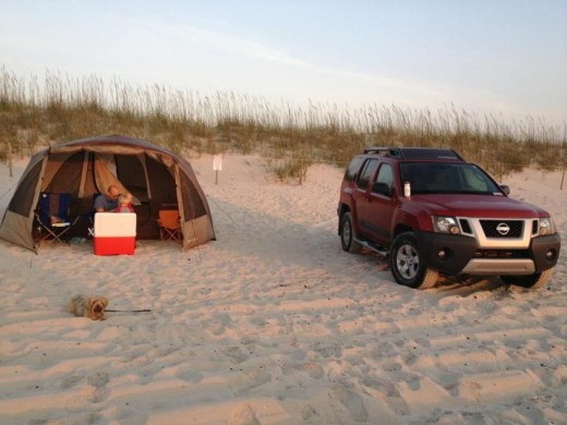 Camping in a tent on the beach