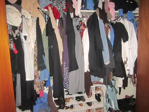 A closet packed full of clothes, many of which are not worn. Who needs more clothing?