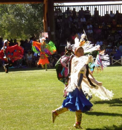 Women dancers take the field at Kamloopa Pow Wow 2012.