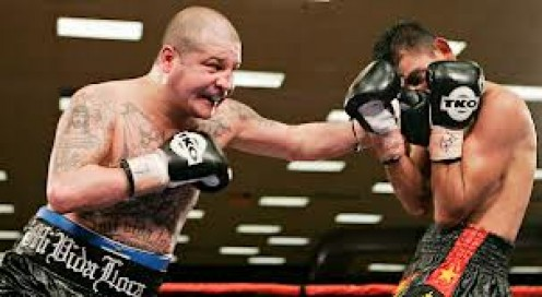 Johnny Tapia unleashes a flurry in defense of his bantamweight championship. Tapia fought on emotion many times but he was also an exceptional boxer.