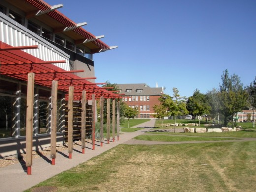 The verandah shades the south windows of the Sk'elup School of Excellence library, facing east toward the old St Joseph Indian Residential School.