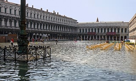 "In 2007 and 2008, St. Mark's Square flooded. Much of Venice floods in the winter and springtime during the ""high water"" time, so it isn't unusual for locals to go about their business in high top rain boots."