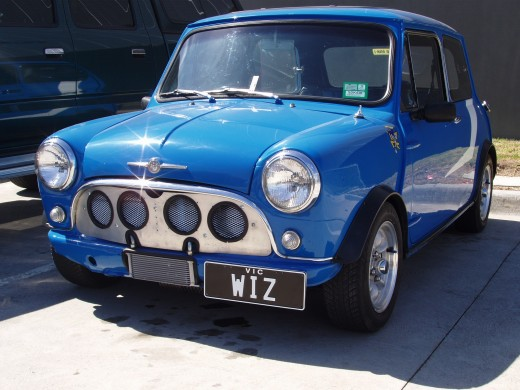 This bright blue Mini Morris is considered a classic car.  International definitions vary, but a classic car is 20 - 40 years old and in optimal condition.