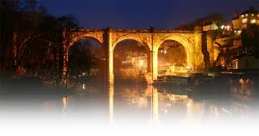 Knaresborough's railway Viaduct in the evening - the old bridge is beyond, below the old castle