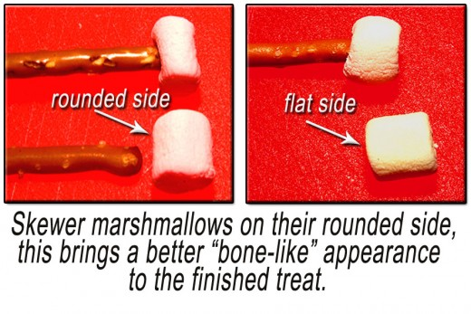 Skewer marshmallows on their round side with the pretzel. Place one marshmallow on each end of each pretzel stick.