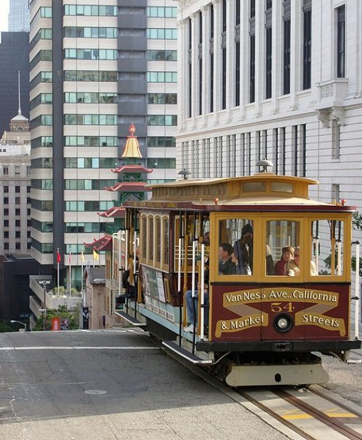 This cable car coming uphill in Chinatown in San Francisco was photographed by Fred Hsu on December 25, 2006. The cable car has just crested the hill. Look how steep the street is!