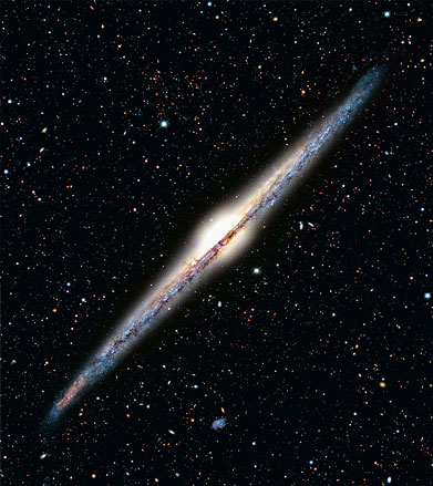 An edge-on spiral galaxy looks like a flattened disk. It contains both old and young stars