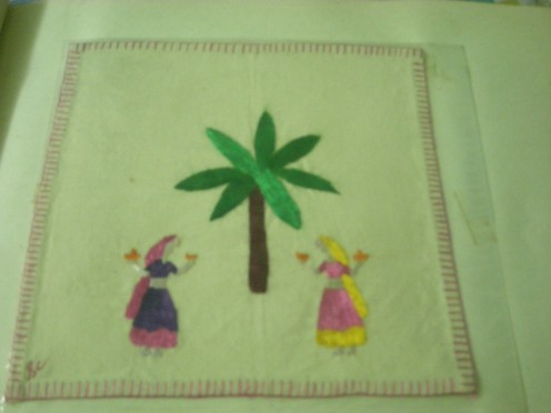 Sample of a chumba rumal depicting a couple of dancing ladies around a plaintain tree