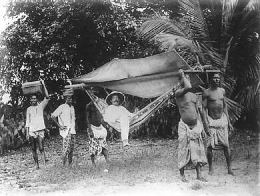 German colonial lord with his slaves around 1885