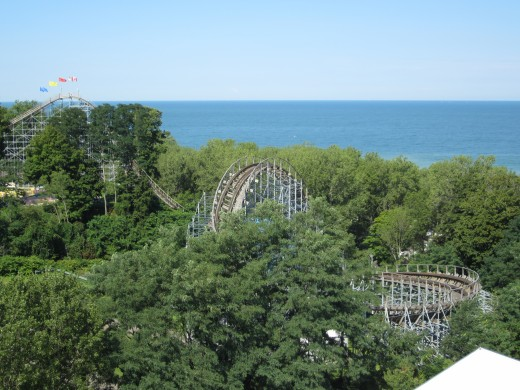 Waldameer Parks' Ravine Flyer II Return Hill (as viewed from TREC).  In the distance, lift hill on left and Lake Erie on right.
