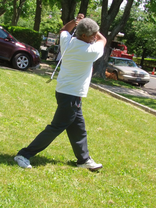 He has quite the golf swing, but is there something wrong with this picture?