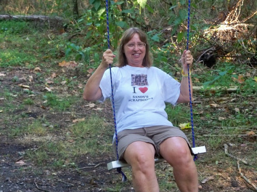 Sandy on a swing in the woods