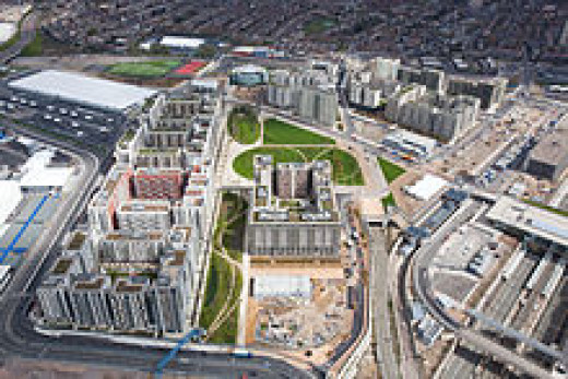 Olympic Village is to become the new neighbourhood of East London at Stratford with private and public housing, schools, shops, transportation, and an orchard.