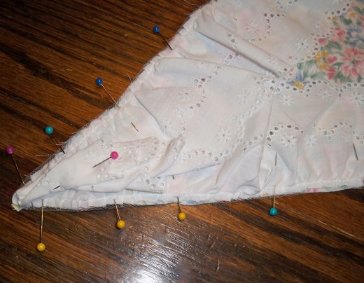 In the corners take care to pin trim out of the way of seam lines.