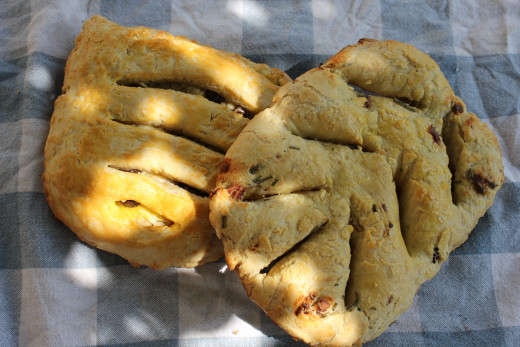 Two styles of Fougasse. Left: Olive and Goat Cheese. Right: Anchovies and Rosemary.