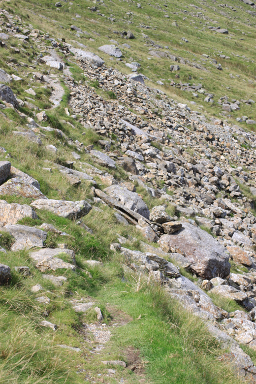 Follow the rugged path around the edge of Levers Water