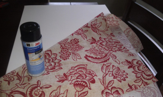 materials needed, spray adhesive, stretched canvas, and fabric of choice