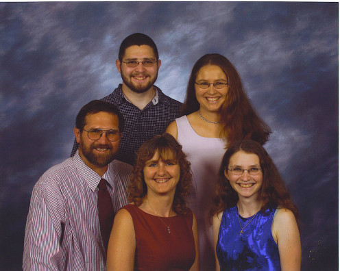 Me and my family all with glasses or contacts.