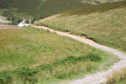 Follow the more prominent path which gives great views of the Coniston Coppermines YHA in the distance