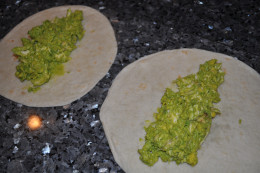 Lay out your tortillas and divide the mixture between the two.