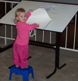 Find new ways to use existing furniture to save money. Mom's drafting table becomes an easel for daughter.