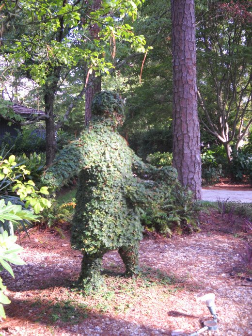 Sower topiary, person scattering seed
