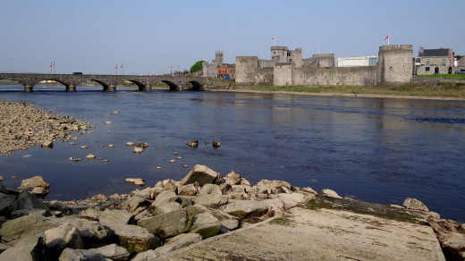King John's Castle on the River Shannon in Limerick City, Ireland. Crossing the river is the Thomand Bridge.