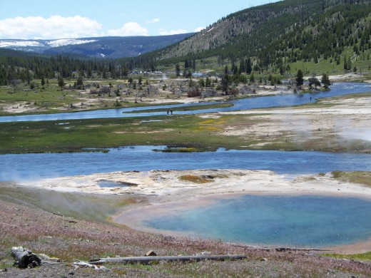 Geyser Basin in Yellowstone NP - If you look close you can see a few guys fly fishing