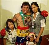 WBC lightweight champion Boxer Edwin Valero, 28, wife Jennifer, 24, with their children