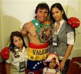 WBC lightweight champion Boxer Edwin Valero, 28, wife Jennifer, 24, with their children