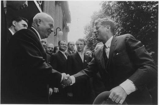 President Kennedy and Khrushshev shake hands.