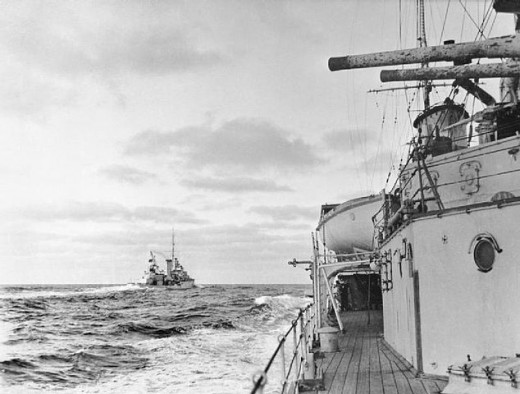 A photo showing the two light cruisers, HMS Ajax and HMNZS Achilles, at action stations