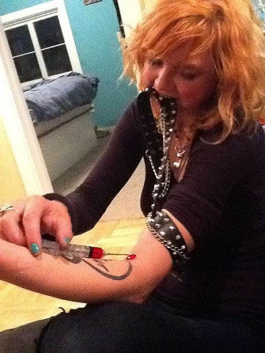 Heroin Addict shooting heroin intravenously