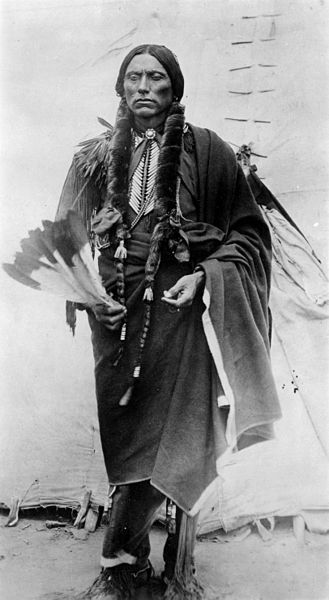 Chief Quanah Parker in ceremonial attire in 1885.