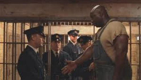 The Green Mile was written by Stephen King and it stars Tom Hanks and Michael Duncan Clark.