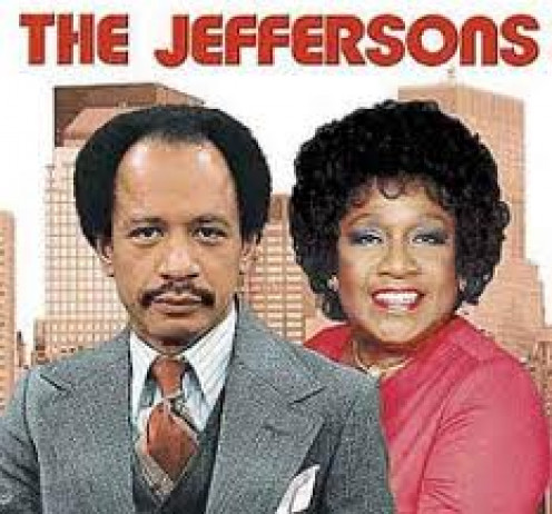 The Jeffersons starred Sherman Hemsley and the show was a spin off from All in the Family. George Jefferson owns a Dry cleaning and clothes washing store.